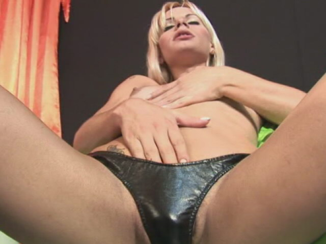 Blonde TS Thays Schiavinato plays her small breast and cock