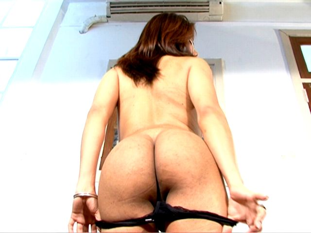Brunette transgirl with big tits Selia sucking a hard penis on the knees