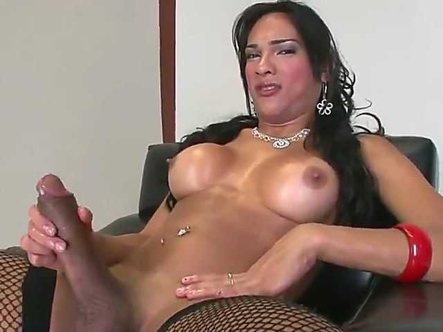 Amazing brunette shemale Jo Garcia with delicious big breasts wanking  huge schlong