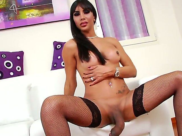 Brunette Samantha Q is one horny shemale eager to stroke that big cock in wild solo