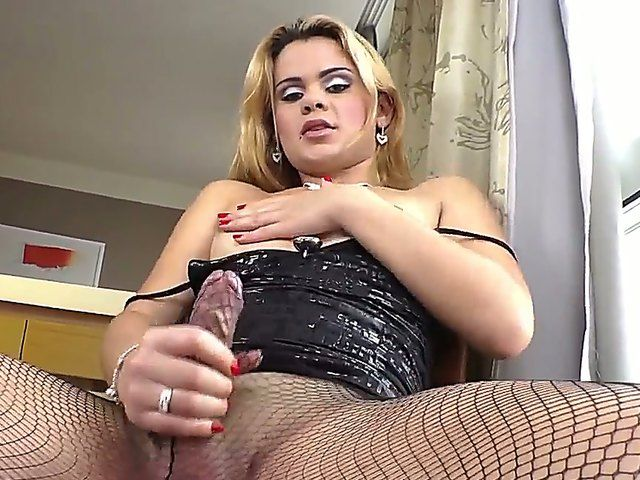 The attractive shemale Josiane in the sexy lingerie masturbates her appetizing cock