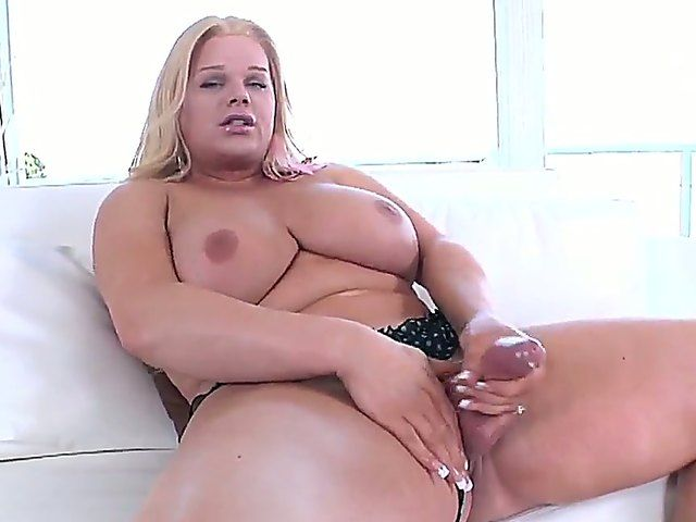 The big busty she-male Holly Sweet masturbates his small dick and penetrates his ass with a dildo