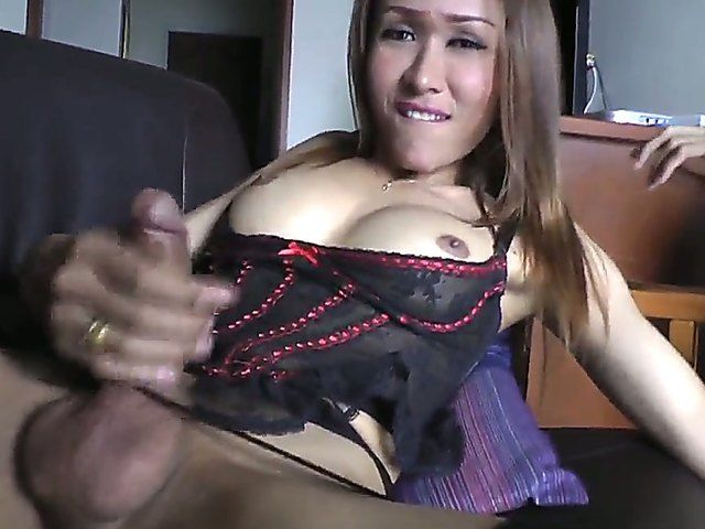 The hot and dirty masturbates with the fantastic Asian she-male Apple in seductive lingerie