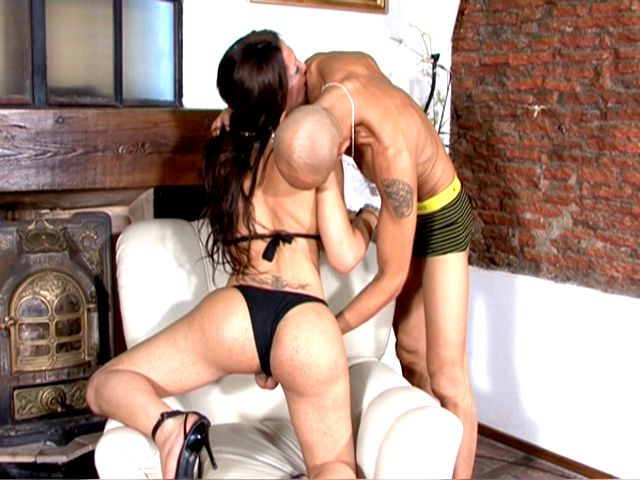 Seductive brunette tranny whore Triany getting big tits licked and cock jerked by a bald stud