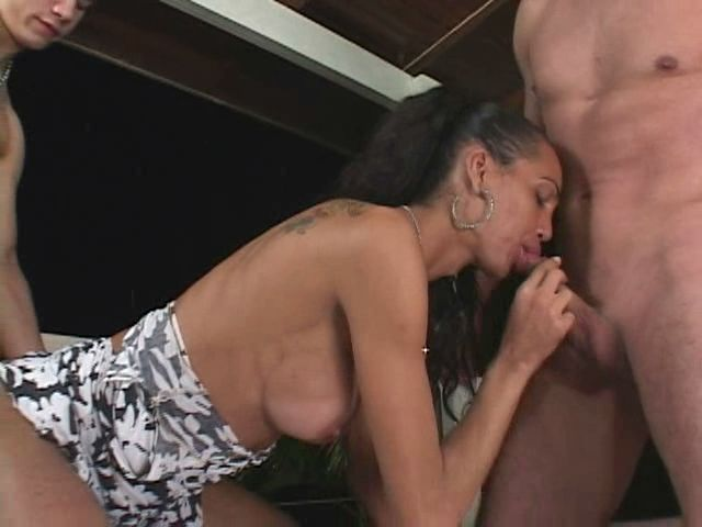 Tempting blond tranny doll getting big dick and round jugs sucked by two studs outdoors