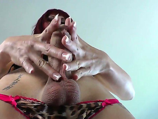 Asian tranny with vivid make up on her face is revealing boobs and jerking off a shaved dick