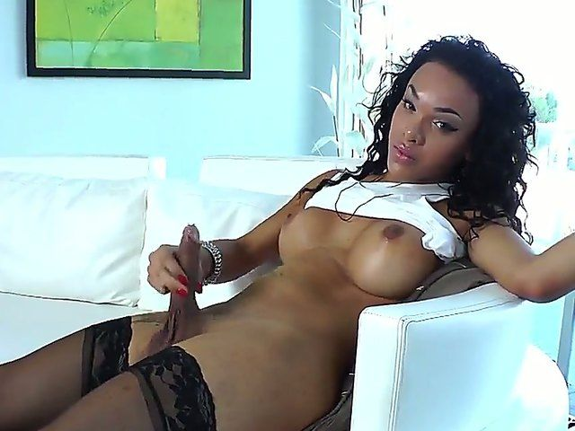 Beautiful ebony tranny took off his huge pierced dick and is stroking it