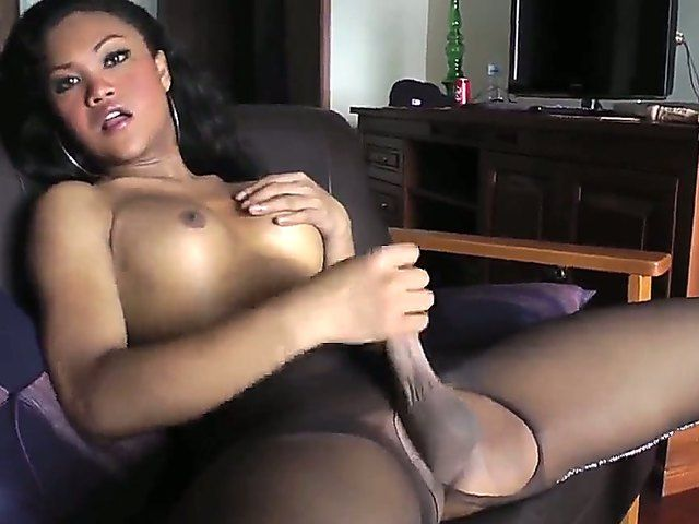 The prepossessing Asian she-male Ming with an appetizing boobs masturbates his dick
